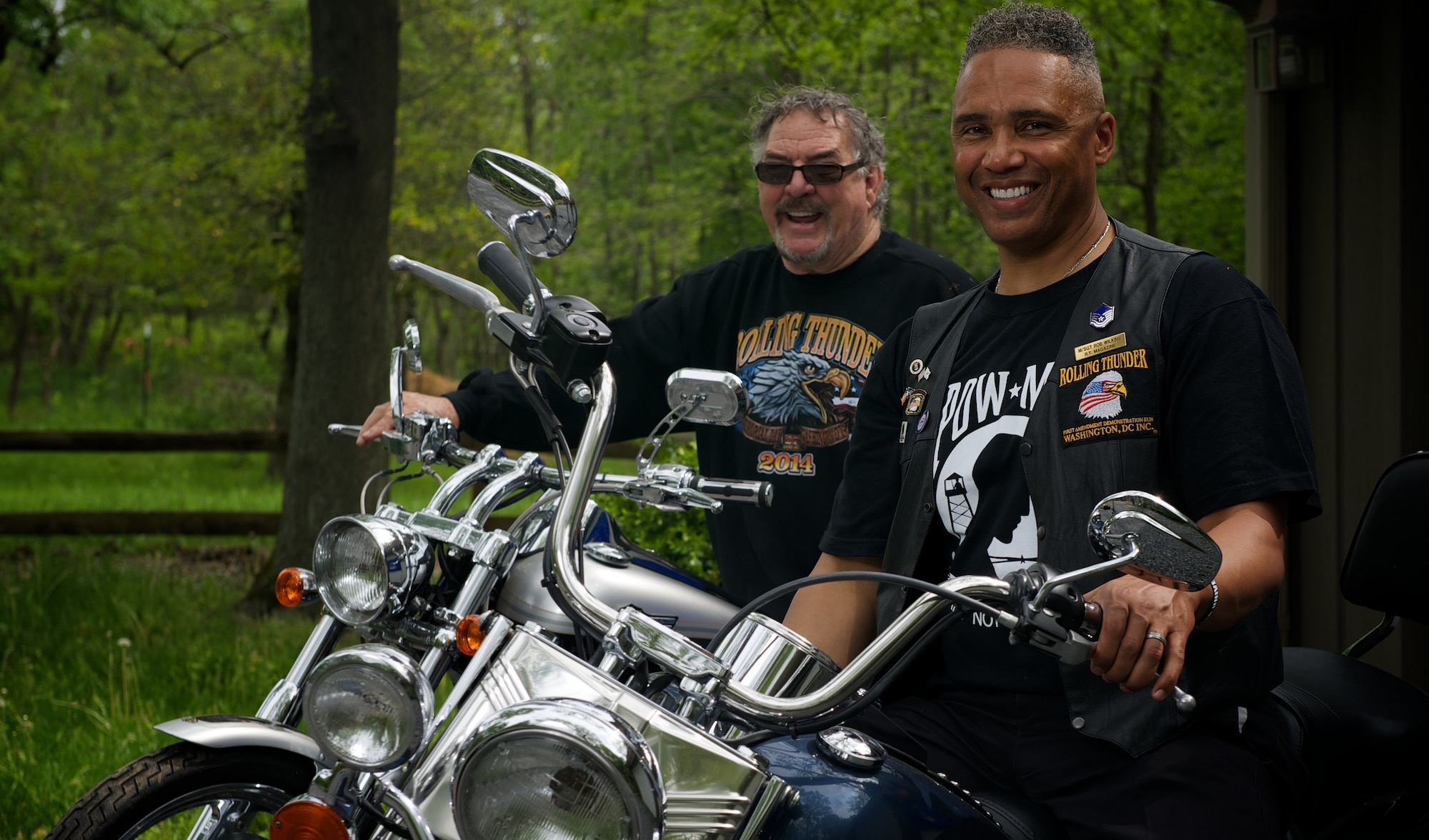 Retired Master Sgt. Rob Wilkins, front, and retired Marine 1st Sgt. Walt Sides pose for a portrait May 15, 2014, at Sides' farm outside Leesburg,Va. Wilkins and Sides are directors of Rolling Thunder, the annual motorcycle demonstration run through Washington, D.C., which attempts to raise awareness of military veterans, prisoners of war and missing in action personnel. (U.S. Air Force photo/Senior Airman Alexander W. Riedel)