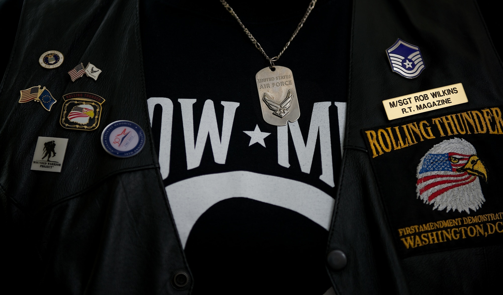Rob Wilkins displays pins and his former Air Force rank on his Rolling Thunder motorcycle vest May 15, 2014, at his office in Leesburg, Va. Wilkins is part of the board of directors of Rolling Thunder, the annual Memorial Day motorcycle rally through Washington, D.C. (U.S. Air Force photo/Senior Airman Alexander W. Riedel)