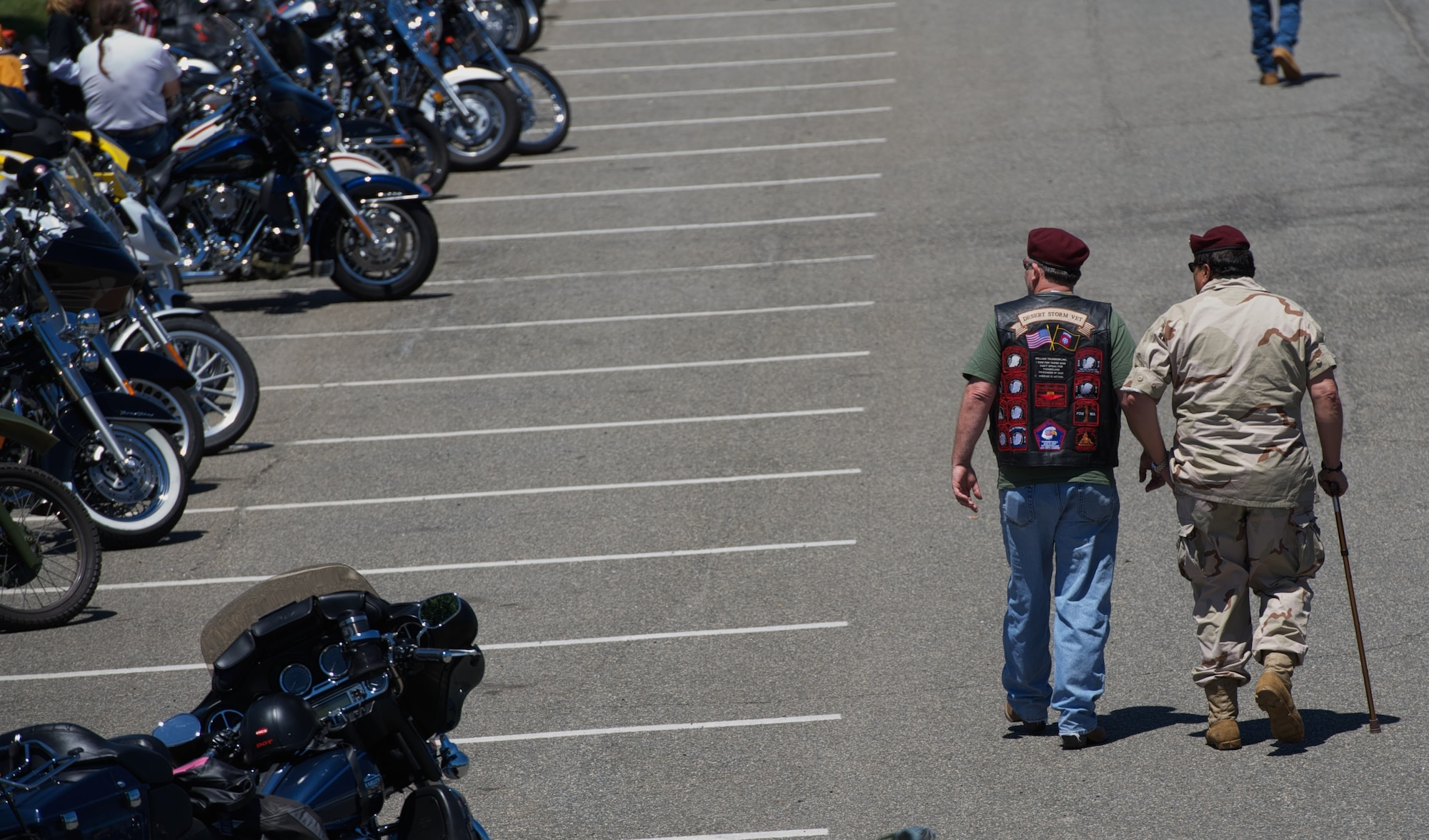 Desert Storm veterans stroll by parked motorcycles, staged for Rolling Thunder May 26, 2013 at the Pentagon in Washington, D.C. The annual Memorial Day motorcycle demonstration run attracts many war veterans and service members, who commemorate their lost and missing comrades on the occasion of memorial day. (U.S. Air Force photo/Senior Airman Alexander W. Riedel)
