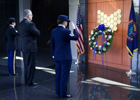 DIA's Deputy Director David Shedd and members of the DIA Color Guard salute following a Memorial Day wreath laying at the agency's Patriots Memorial.