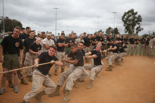 MARINE CORPS AIR STATION MIRAMAR, Calif. – Marines compete in a tug-of-war match during the Stronger Warrior Field Meet at Marine Corps Air Station Miramar, Calif., May 22. The meet was one of several events being held for the three-month 101 Days of Summer program to emphasize participating Marines' overall strengths.