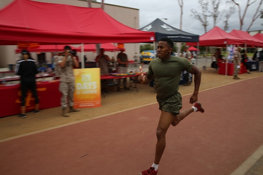 MARINE CORPS AIR STATION MIRAMAR, Calif. – Lance Cpl. Emanual Cooper, consolidated automated support system tech with Marine Aviation Logistics Squadron (MALS) 16 competes in a relay race during the Stronger Warrior Field Meet at Marine Corp