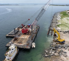 A crane lowers a marine mattress as part of Barnegat Inlet north jetty repair work in May of 2014. The U.S. Army Corps of Engineers' Philadelphia District is repairing the north jetty from damages sustained during Hurricane Sandy.