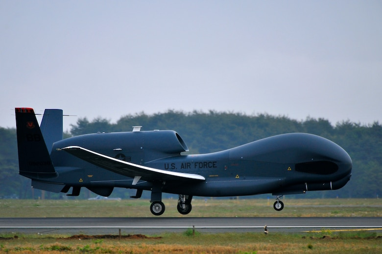 An RQ-4 Global Hawk from Andersen Air Force Base, Guam lands at Misawa Air Base, Japan, May 24, 2014. The remotely piloted system supports U.S. intelligence, surveillance, and reconnaissance missions and contingency operations throughout the Pacific theater. The Global Hawk will be temporarily assigned to Misawa AB until October. (U.S. Air Force photo/Staff Sgt. Nathan Lipscomb)
