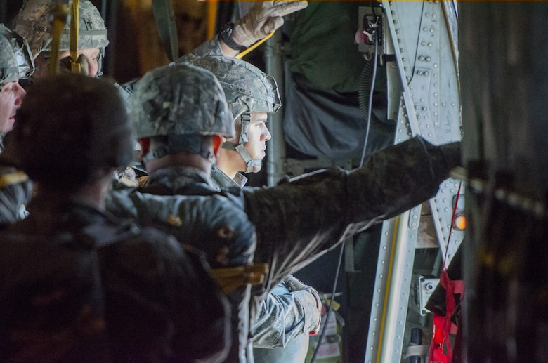 Soliders from the 2-377th Parachute Field Artillery Regiment, 4th IBCT 25 Infantry Division get ready to perform a static line jump out of a Kentucky Air National Guard C-130 Hercules just north of Joint Base Elmendorf-Richardson, Alaska, on May 13, 2014. 165th Airlift Squadron aircrews are receiving a lot of great training while participating in Red Flag-Alaska. (U.S. Air National Guard photo by Master Sgt. Phil Speck)