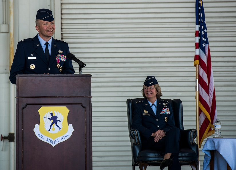 Maj. Gen. Barbara Faulkenberry, 18th Air Force commander, Col. Darren Hartford and Col. John Lamontagne, salute the American flag during the National Anthem before the 437th Airlift Wing change of Command ceremony on May 22, 2014, in Nose Dock 2 at Joint Base Charleston - Air Base, S.C. (U.S. Air Force photo/Senior Airman Dennis Sloan)
