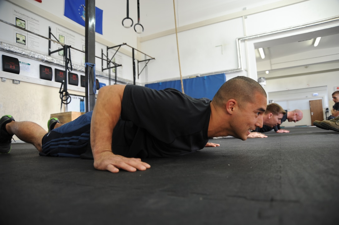 U.S. Air Force Tech. Sgt. James Yerger, 52nd Fighter Wing Safety office ground safety manager, competes in the pushup event during the Wing Staff Agencies Iron Airman competition May 23, 2014, at Spangdahlem Air Base, Germany. The event showcased seven exercises to determine the overall male and female winners. (U.S. Air Force photo by Airman 1st Class Dylan Nuckolls/Released)