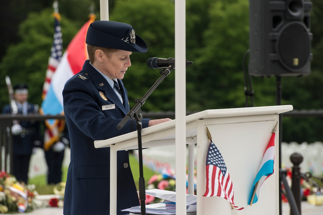 U.S. Air Force Col. Cherri Wheeler, U.S. Air Forces in Europe command chaplain, recites a prayer during a Memorial Day ceremony at the Luxembourg-American Military Cemetery and Memorial, Luxembourg, May 24, 2014. Through relationships with partner countries, U.S. Air Forces in Europe and Air Forces Africa Airmen have successfully supported humanitarian, contingency and daily operations anywhere across the European region. (U.S. Air Force photo by Staff Sgt. Christopher Ruano/Released)