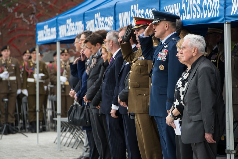 U.S. and Luxembourg dignitaries offer their respects during a Memorial Day ceremony at the Luxembourg-American Military Cemetery and Memorial, Luxembourg, May 24, 2014. Remaining forward, U.S. Air Forces in Europe and Air Forces Africa maintains its readiness to execute NATO commitments and to preserve our allied and partner relationships. (U.S. Air Force photo by Staff Sgt. Christopher Ruano/Released)