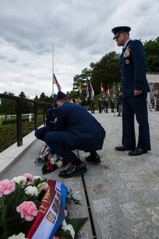 Two U.S. Air Force Airmen place a wreath for U.S. Air Force Gen. Frank Gorenc, U.S. Air Forces in Europe and Air Forces Africa commander, to honor the men and women of the U.S. military, past and present during a Memorial Day ceremony at the Luxembourg-American Military Cemetery and Memorial, Luxembourg, May 24, 2014. USAFE-AFAFRICA maintains a forward presence allowing the building of new and deeper partnerships across Europe and Africa like coming together to honor those who have made the ultimate sacrifice. (U.S. Air Force photo by Staff Sgt. Christopher Ruano)