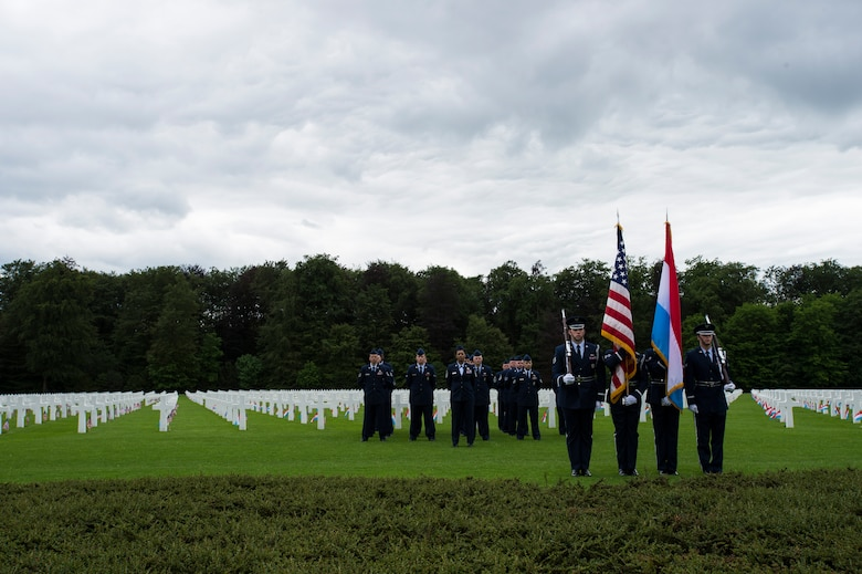The 52nd Fighter Wing Honor Guard presents the Luxembourg and U.S. flags during a Memorial Day ceremony at the Luxembourg-American Military Cemetery and Memorial, Luxembourg, May 24, 2014. Members of the Luxembourg military were also present to participate in the ceremony and to show their respects. The cemetery is home to more than 5,000 service members who died during World War II. (U.S. Air Force photo by Staff Sgt. Christopher Ruano/Released)