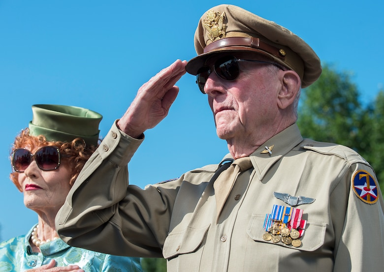 Capt. Jerry Yellin, a World War II P-51 pilot and the national spokeman for the Spirit of 45 Organization renders honors during a Memorial Day wreath-laying ceremony May 26, 2014, at the Air Force Memorial, Arlington, Va. During his keynote address, Chief Master Sgt. of the Air Force James A. Cody urged audience members to remember the fortitude shown by the nation's fallen in fighting and standing their ground. (U.S. Air Force photo/Jim Varhegyi)