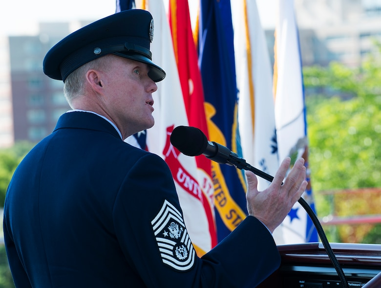 Chief Master Sgt. of the Air Force James A. Cody provides his keynote speech during a Memorial Day wreath-laying ceremony held May 26, 2014, at the Air Force Memorial in Arlington, Va. Cody remarked that for him on Memorial Day the three spires of the memorial stood for freedom, fortitude and our fallen -- who are still with us in our stories and our memories, and give us cause to wave our flags. (U.S. Air Force photo/Jim Varhegyi)