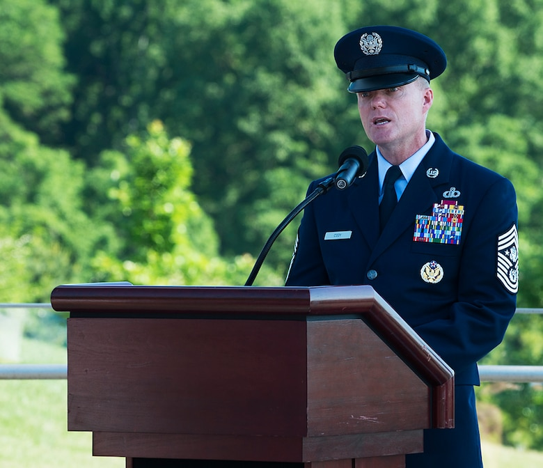 Chief Master Sgt. of the Air Force James A. Cody speaks during a Memorial Day wreath-laying ceremony held May 26, 2014, at the Air Force Memorial, Arlington, Va. Cody remarked that for him on Memorial Day the three spires of the memorial stood for freedom, fortitude and our fallen -- whose sacrifices give us cause to wave our flags today and in the future. (U.S. Air Force photo/Jim Varhegyi)