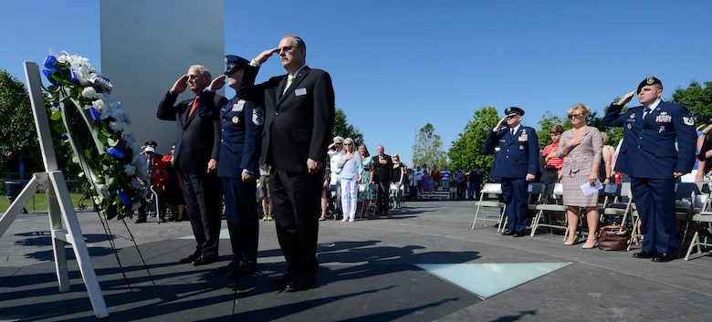 From right, Air Force Sergeant's Association International President retired Chief Master Sgt. Daniel Yeomans, Chief Master Sgt. of the Air Force James A. Cody and Air Force Association President retired Gen. Craig McKinley lay a Memorial Day wreath during a ceremony held at the Air Force Memorial,  May 26, 2014, in Arlington, Va. Cody provided the keynote speech remarking that for him, on Memorial Day, the three spires of the memorial stood for freedom, fortitude and our fallen. Cody then told the crowd that today, and everyday, our fallen are with us in our stories and our memories, and they give us cause to wave our flags. (U.S. Air Force photo/Jim Varhegyi)