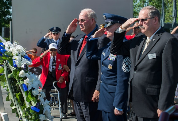 From right, Air Force Sergeant's Association International President retired Chief Master Sgt. Daniel Yeomans, Chief Master Sgt. of the Air Force James A. Cody and Air Force Association President retired Gen. Craig McKinley lay a Memorial Day wreath during a ceremony held at the May 26, 2014, Air Force Memorial, Arlington, Va. Cody provided the keynote speech remarking that for him on Memorial Day is a day to remember the freedom that we all share because of the fortitude shown by of our fallen comrades in fighting and standing their ground. (U.S. Air Force photo/Jim Varhegyi)