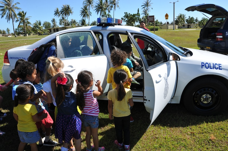 Children from the Andersen Child Development Center explore a police vehicle May 15, 2014, on Andersen Air Force Base, Guam. The 36th Security Forces Squadron demonstrated various types of equipment and skills during the week-long National Police Week event. (U.S. Air Force photo by Senior Airman Cierra Presentado/Released)