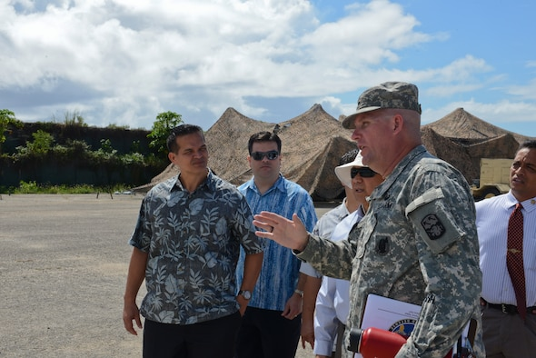 Lt. Col. Clyde Cochrane, commander, Task Force Talon, speaks to a group of Guam Senators at Northwest Field, Guam on May 7, 2014. The senators were visiting the site to gain a deeper understanding of the THAAD mission, which has been at Andersen since April 2013. (U.S. Air Force photo by Airman 1st Class Adarius Petty/Released)