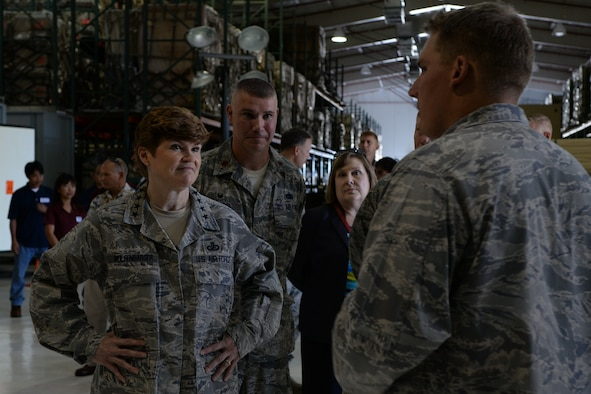 Gen. Janet Wolfenbarger, commander of Air Force Materiel Command, receives a briefing from 2nd Lt. Jeffery Benson, 36th Logistics Readiness Flight, during a tour of the War Reserve Material Base Expeditionary Airfield Resource facility May 10, 2014, on Andersen Air Force Base, Guam. Gen. Wolfenbarger visited numerous sites on Andersen in an effort to improve AFMC's support of Andersen's mission. (U.S. Air Force photo by Airman 1st Class Amanda Morris)
