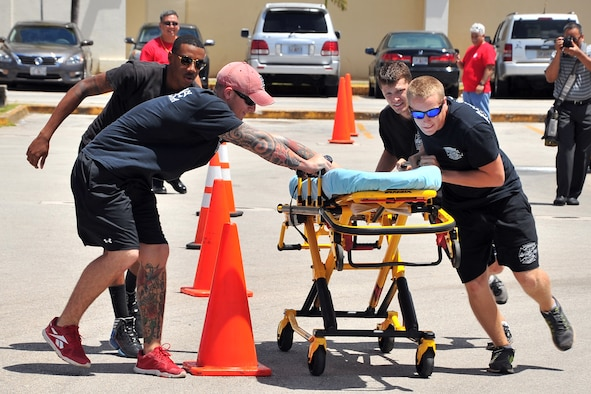 Team Andersen first responders participate in an Emergency Medical Services Rodeo at the Agana Shopping Center, Guam, May 18, 2014. Team Andersen placed first in the event, which was part of a public health fair in recognition of EMS week. (U.S. Air Force photo by Staff Sgt. Melissa B. White/Released)