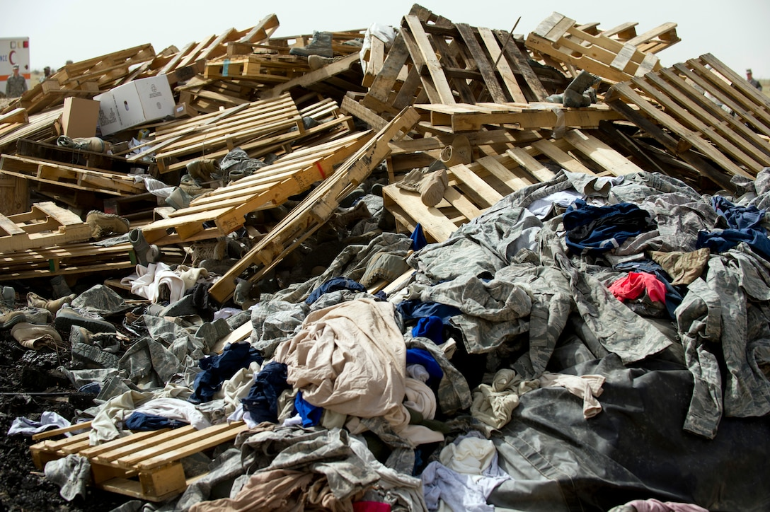 A pile of unserviceable uniforms items await destruction during a training burn by the 386th Expeditionary Civil Engineer Squadron Fire Department April 18, 2014, in Southwest Asia.  The uniforms were collected over the course of a year and were destroyed to ensure they do not end up being utilized improperly if discarded with normal trash.  (U.S. Air Force photo/Senior Master Sgt. Burke Baker)
