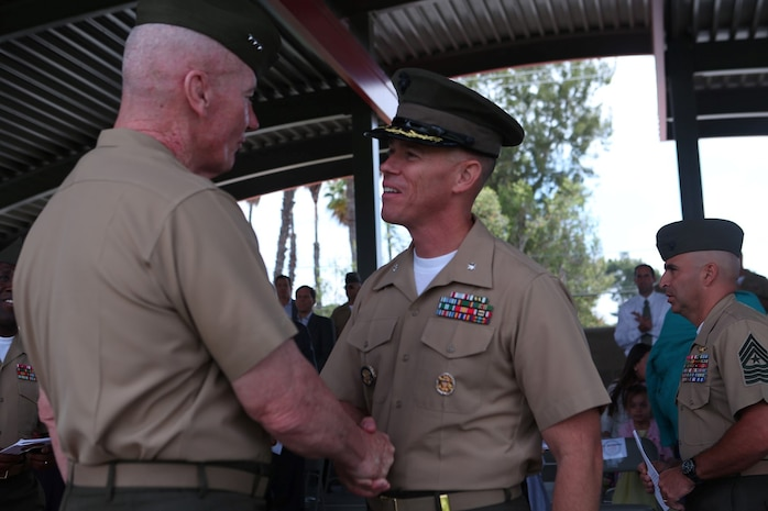 Lieutenant Col. Jan R. Durham, former commanding officer, 1st Law Enforcement Battalion, greets Lt. Gen. John A. Toolan, commanding general, I Marine Expeditionary Force after a change of command ceremony aboard Marine Corps Base Camp Pendleton, Calif., May 23, 2014. During the ceremony, Durham relinquished command of 1st LEB to Lt. Col. Daron M. Mizell.