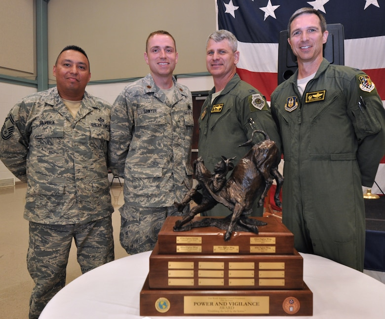 "As the latest recipients of the 10th Air Force Power and Vigilance award, members of the 419th Fighter Wing pose with the trophy. The 419th Fighter Wing at Hill Air Force Base, Utah, was recently proclaimed the premier unit within 10th Air Force, winning trophy bragging rights for the year. The Power and Vigilance Award is presented annually to the 10 AF Reserve unit that exhibits the NAF mission as ""the premier provider of affordable, integrated, flexible, and mission-ready Citizen Airmen to execute power and vigilance missions in support of U.S. National Security."" The symbolism of the bronze figure on the award says it all, 'grabbing the bull by the horns'.  They are only the fifth unit to hold this honor. (U.S. Air Force photo/Master Sgt. Julie Briden-Garcia)"