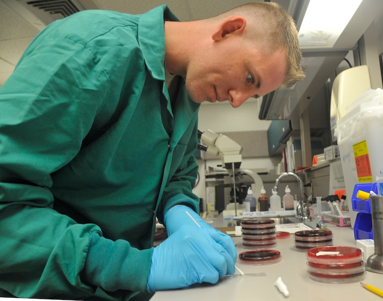 U.S. Air Force Staff Sgt. Jon Ringenoldus, 509th Medical Support Squadron medical laboratory technician, performs a catalase test at Whiteman Air Force Base, Mo., May 13, 2014. This test is done to differentiate between staphylococci (catalase-positive) from streptococci (catalase-negative) bacteria. (U.S. Air Force photo by Airman 1st Keenan Berry/Released)