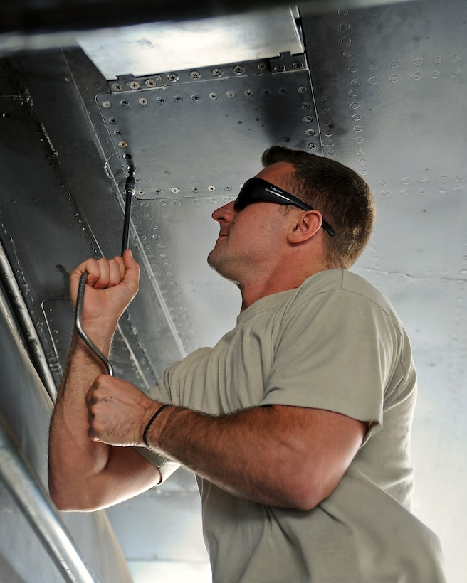 U.S. Air Force Staff Sgt. Billy Trusty Jr., 7th Aircraft Maintenance Squadron B-1B Lancer crew chief, installs a ram air scoop used to cool fuel during flights May 19, 2014, at Dyess Air Force Base, Texas. Trusty joined the Air Force at the age of 19 and has been working on B-1s at Dyess since 2007. (U.S. Air Force photo by Airman 1st Class Kedesha Pennant/Released)