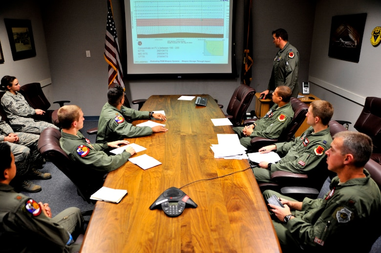 Members of the 11th Reconnaissance Squadron receive a pre-flight briefing from Capt. Marcus, 432nd Operations Support Squadron Weapon System Evaluation Program evaluator, May 12, 2014, Creech Air Force Base, Nev. The 11 RS flew the MQ-9 Reaper in a week-long mission, known as Combat Hammer, where they released the GBU-12 Paveway II and AGM-114 Hellfire munitions. (U.S. Air Force photo by Airman 1st Class C.C./Released)
