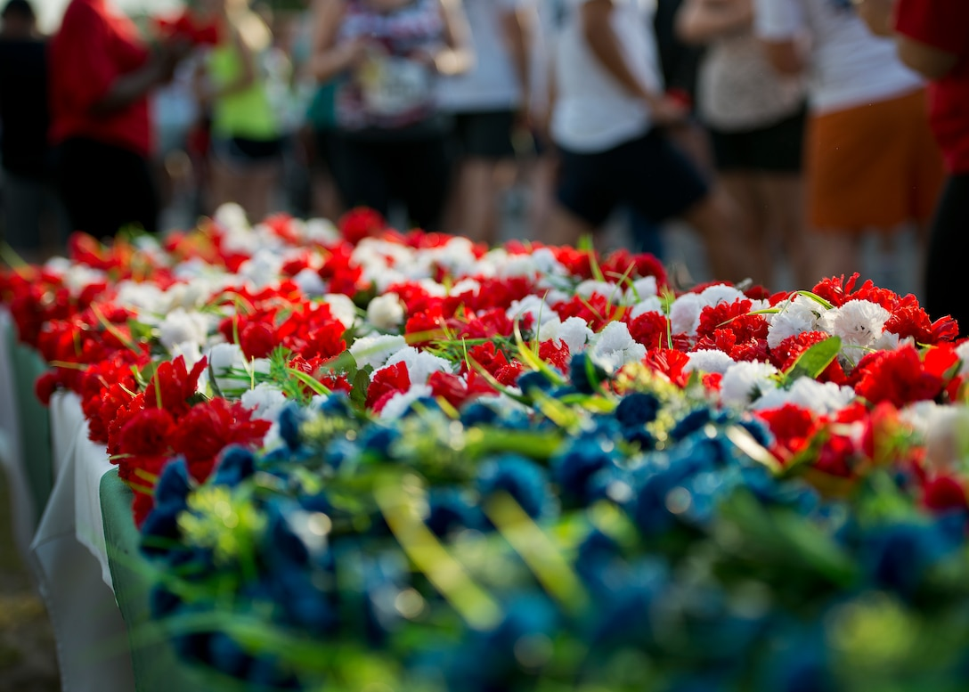 An American flag carnation display held the flowers runners could take and drop at the All Veterans Memorial at the 29th annual Gate-to-Gate Run May 24 at Eglin Air Force Base, Fla. More than 1,200 people participated in the 4.4-mile race. (U.S. Air Force photo/Samuel King Jr.)