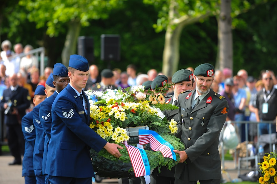 U.S. Air Force Airmen and Dutch service members lay wreaths during a Memorial Day ceremony at the Netherlands American Cemetery May 25, 2014, Margraten, Netherlands. During the ceremony, service members laid more than 60 wreaths to honor the memory of fallen heroes. (U.S. Air Force photo by Senior Airman Rusty Frank/Released)