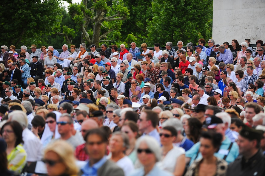 People gather to watch a Memorial Day ceremony at the Netherlands American Cemetery May 25, 2014, Margraten, Netherlands. The event is one of the largest ceremonies held at an overseas American Battle Monument Commission cemetery. (U.S. Air Force photo by Senior Airman Rusty Frank/Released)