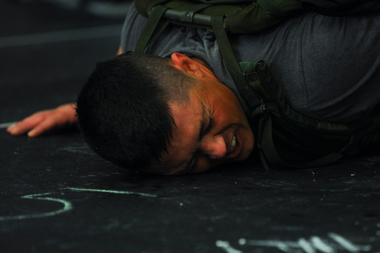 """Dave Esra, 52nd Force Support Squadron recreation assistant, rests during a combat fitness workout as a part of a """"Murph"""" Challenge May 23, 2014, at Spangdahlem Air Base, Germany. The event is held annually in memoriam of the actions of U.S. Navy Lt. Michael Murphy. More than 67 Airmen participated in the event. (U.S. Air Force photo by Senior Airman Rusty Frank/Released)"""