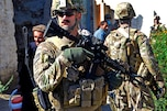 U.S. Navy Lt. Collin Korenek, front, provides security during a key leader engagement with district leaders in the Noorgul district center in Afghanistan's Kunar province, Oct. 1, 2012. Korenek is assigned to Provincial Reconstruction Team Kunar.