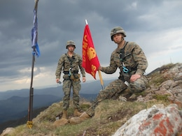 Corporal Scott Bradley and Lance Cpl. Dakota Marshall, two Marines with Black Sea Rotational Force 14 from 3rd Battalion, 8th Marine Regiment, reach the peak of a cliff with two Romanian soldiers of the 17th Mountain Troop Bn. during Exercise Platinum Lynx in the Carpathian Mountains, May 8, 2014. Exercise Platinum Lynx 14-5 is a bilateral exercise between the United States Marines and sailors, and Romanian Land Forces, designed to build familiarity and interoperability between the United States and their Romanian allies through squad and platoon level infantry training. (Courtesy photo)