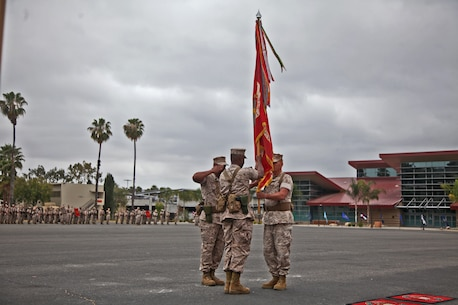 Colonel Tracy King, commanding officer, Combat Logistics Regiment 15, 1st Marine Logistics Group, passes his regiment's battle colors to Col. Seth Ocloo during a change of command ceremony aboard Camp Pendleton, Calif., May 22, 2014. Ocloo, who recently served as the assistant chief of staff for logistics at the 3rd Marine Aircraft Wing, received his new duty with enthusiasm.