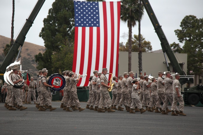 Marine Band San Diego marches across the parade deck during a change of command ceremony for Combat Logistics Regiment 15, 1st Marine Logistics Group, aboard Camp Pendleton, Calif., March 22, 2014.  Colonel Tracy King, commanding officer, Combat Logistics Regiment 15, 1st Marine Logistics Group, passed on the responsibility, authority and accountability of CLR-15 to Col. Seth Ocloo, who recently served as the assistant chief of staff for logistics at the 3rd Marine Aircraft Wing. (U.S. Marine Corps photo by Lance Cpl. Keenan Zelazoski)
