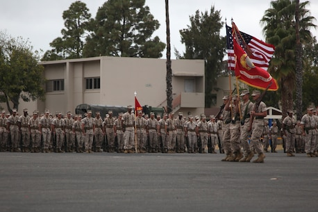 Marines with Combat Logistics Regiment 15, 1st Marine Logistics Group, march the colors onto the parade deck during their change of command ceremony aboard Camp Pendleton, Calif. May 22, 2014. Ocloo recently served as the assistant chief of staff for logistics at the 3rd Marine Aircraft Wing, received his new duty with enthusiasm.