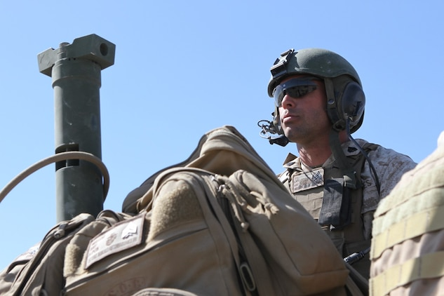 Sgt. Garrett Mellor, a gunner with Delta Company, 1st Light Armored Reconnaissance Battalion, scouts targets for a call for fire during Exercise Desert Scimitar aboard Marine Corps Air Ground Combat Center Twentynine Palms, Calif., May 13, 2014. Mellor, from Arlington, Texas, operates a M242 25mm cannon, an M240B machine gun and two 4-barrel smoke grenade launchers.
