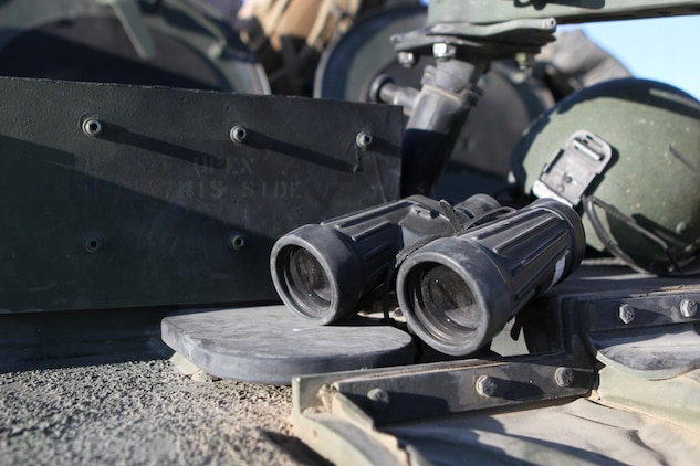 Binoculars are staged in preparation to be used for reconnaissance for live-fire training during Exercise Desert Scimitar aboard the Combat Center, Twentynine Palms, Calif., May 14, 2014. The binoculars are used by the vehicle commander to scout checkpoints, targets, and observe terrain features for enemy threats during convoys.