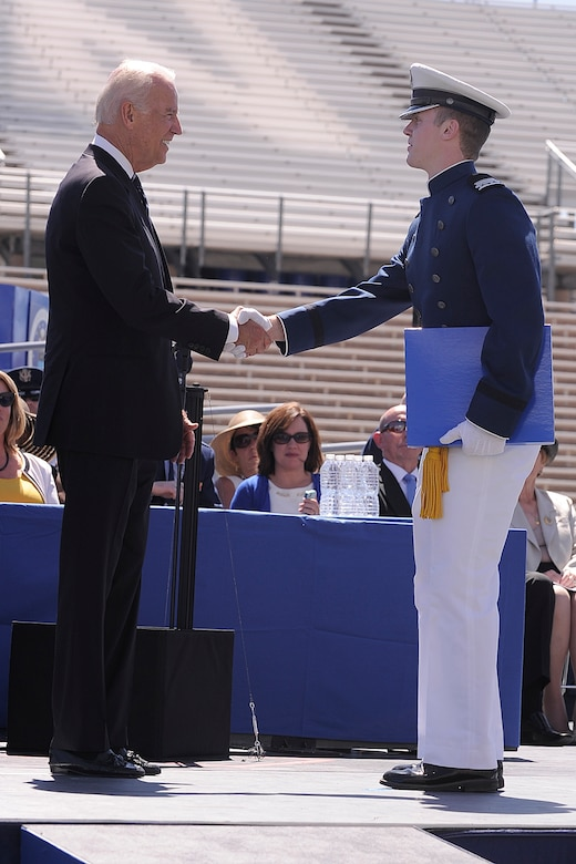 Cadet 1st Class David McCarthy receives his diploma from Vice President Joseph R. Biden during the Air Force Academy graduation ceremony May 28, 2014 in Colorado Springs, Colo. McCarthy was the top cadet among the 995 men and women comprising the Class of 2014. (U.S. Air Force photo/Sarah Chambers)