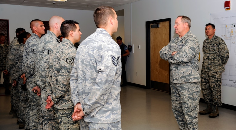 Air Force Chief of Staff Gen. Mark A. Welsh III talks with 460th Security Forces Squadron members during a visit May 27, 2014, to Buckley Air Force Base, Colo. Welsh's trip to Buckley included mission briefings, Airmen recognition and a chance for the base to meet the Air Force's top officer. (U.S. Air Force photo by Airman 1st Class Samantha Saulsbury/Released)