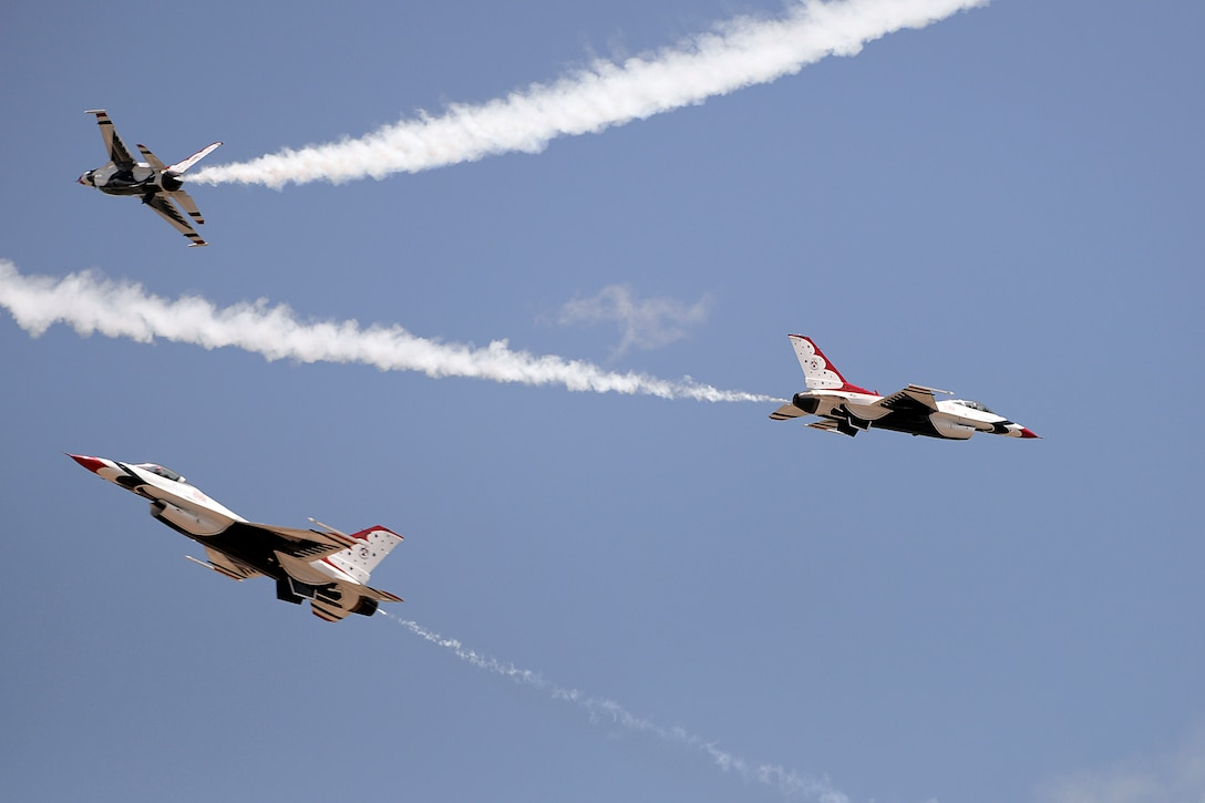 The U.S. Air Force Thunderbirds Aerial Demonstration Squadron perform during the U.S. Air Force Academy Class of 2014 commencment ceremony in Colorado Springs, Colo. May 28, 2014. (U.S. Air Force photo/Mike Kaplan)