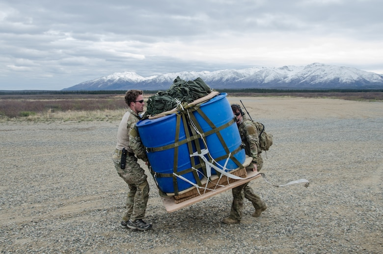 Tech. Sgt. Jeff Kinlaw (left) and Master Sgt. Harley Bobay, combat controllers from the Kentucky Air National Guard's 123rd Special Tactics Squadron, prepare a container delivery system bundle for loading onto a Kentucky Air National Guard C-130 Hercules at the Donnelly drop zone in the Pacific-Alaska Range Complex as part of Red Flag-Alaska on May 21, 2014. More than 100 Kentucky Airmen participated in the exercise from May 7 to 23. (U.S. Air National Guard photo by Master Sgt. Phil Speck)