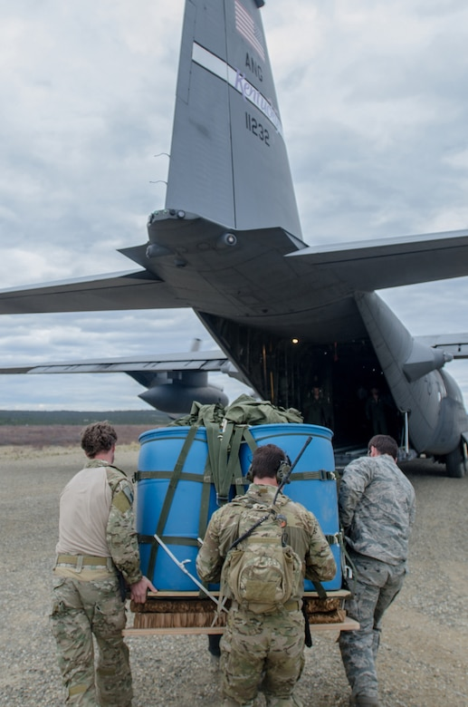 Combat controllers from the Kentucky Air National Guard's 123rd Special Tactics Squadron load a container delivery system bundle onto a Kentucky Air National Guard C-130 Hercules at the Donnelly drop zone in the Pacific-Alaska Range Complex as part of Red Flag-Alaska on May 21, 2014. More than 100 Kentucky Airmen participated in the exercise from May 7 to 23. (U.S. Air National Guard photo by Master Sgt. Phil Speck)