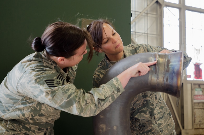 Tech. Sgt. Tracy Cordy (right), chief of supply for the Kentucky Air National Guard's deployed forces during exercise Red Flag-Alaska, and Staff Sgt. April Kennedy, Red Flag-Alaska supply liaison, inspect an item for turn-in at Joint Base Elmendorf-Richardson, Alaska, on May 19, 2014. More than 100 Kentucky Airmen participated in the exercise from May 7 to 23. (U.S. Air National Guard photo by Master Sgt. Phil Speck)