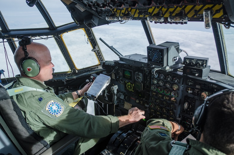 Lt. Col. Dave Flynn, a pilot for the Kentucky Air National Guard's 165th Airlift Squadron, flies a Kentucky Air Guard C-130 Hercules in the skies of Alaska during a training scenario as part of Red Flag-Alaska on May 13, 2014. More than 100 Kentucky Airmen participated in the exercise from May 7 to 23. (U.S. Air National Guard photo by Master Sgt. Phil Speck)