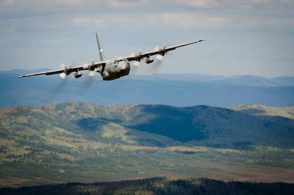 A Kentucky Air National Guard C-130 flies over Alaska on May 9, 2014, in support of Exercise Red Flag-Alaska. More than 100 Kentucky Airmen from the 123rd Airlift Wing participated in the exercise from May 7 to May 23. Red Flag-Alaska is designed to hone the combat skills of U.S. Air Force flight crews. (U.S. Air National Guard photo by Master Sgt. Phil Speck)