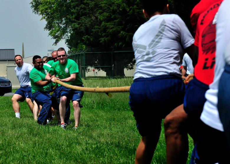 Airman from the 436th Comptroller Squadron and the 436th Logistics Readiness Squadron compete in the tug-o-war competition during Wingman Day May 22, 2014, at the Eagles Nest Park on Dover Air Force Base, Del.Tug-o-war was limited to ten people per team and it was a single elimination tournament. (U.S. Air Force photo/Staff Sgt. Elizabeth Morris)